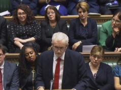 Labour party conference: Corbyn plays down division amid aid's exit