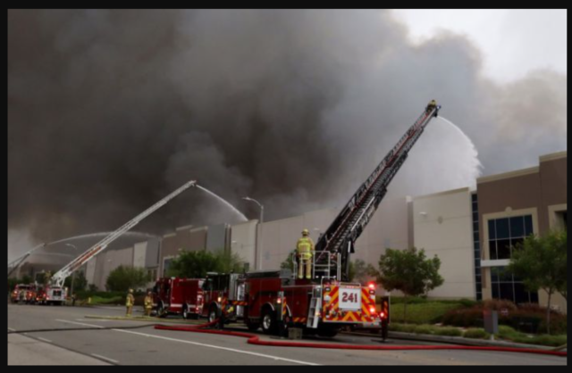 Massive fire at warehouse forces closure of 10 Freeway in Redlands